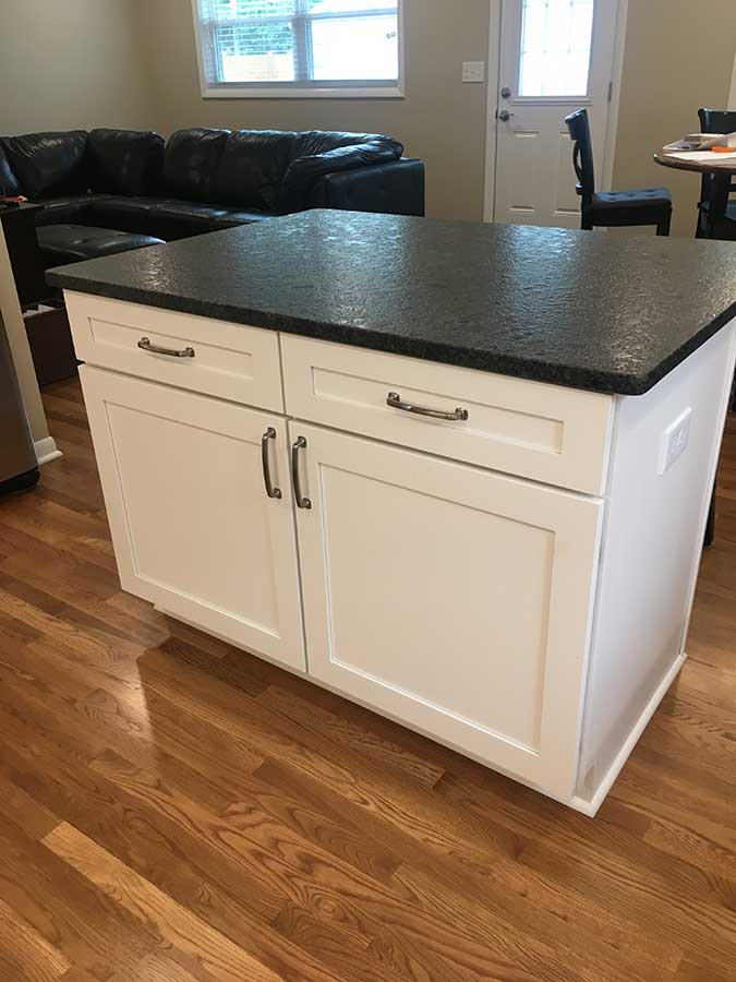 After - Island with Leathered Granite Countertops