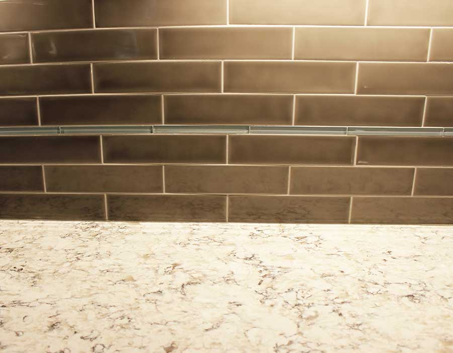 After - Quartz Countertops and Elongated Subway Tile Backsplash