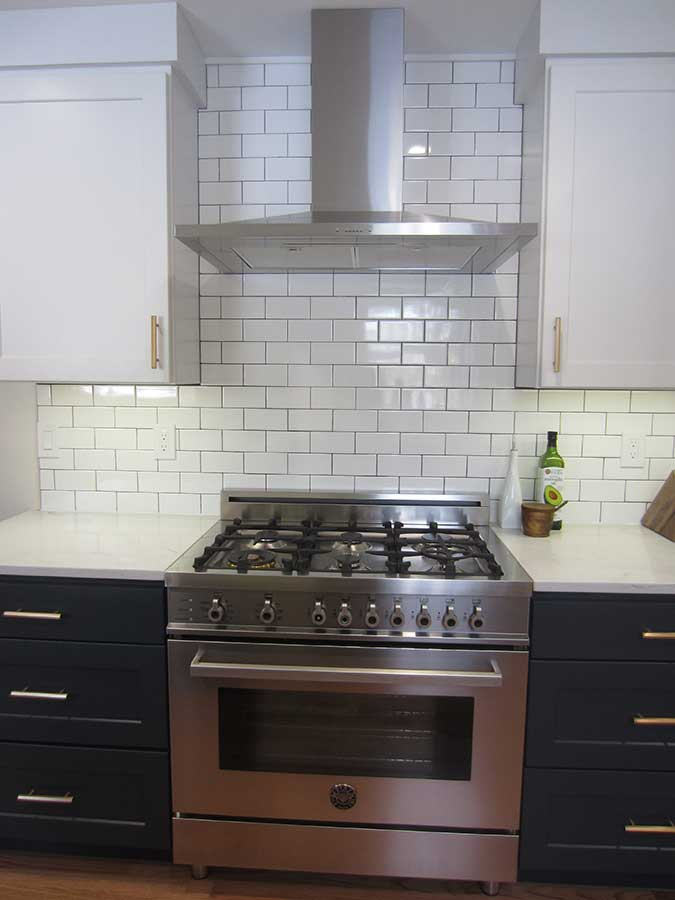 After - Updated Chimney Hood and White Subway Tile