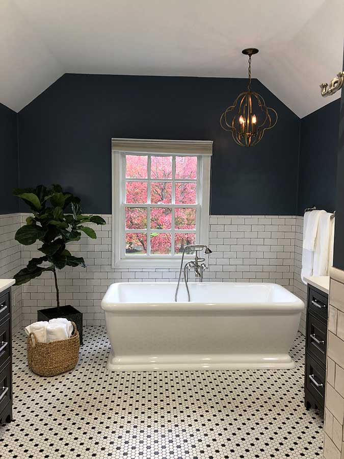 After - Updated Free-Standing Soaking Tub And Tile Wainscotting